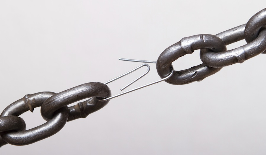 Chainlink with a paperclip holding it together.