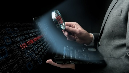 businessman searching virus in a laptop